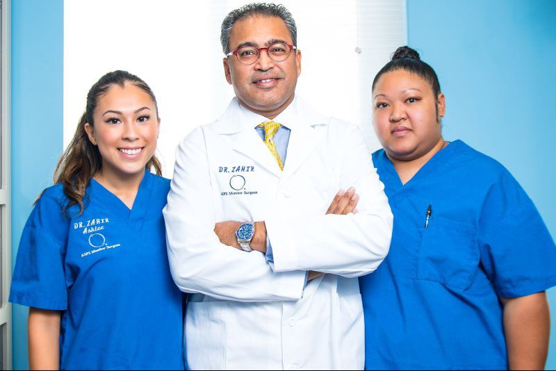 Dr. Zahir and two nurses